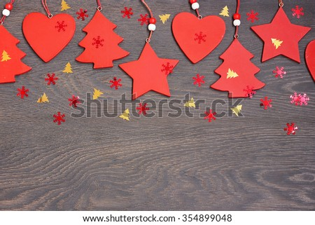 Happy New year and Merry Christmas! New Year's background. Red decorative Christmas-tree decorations against a dark background.  - stock photo