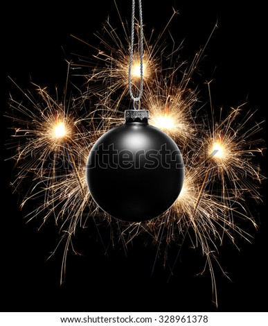 Happy new year background with a black ornament and fireworks - stock photo