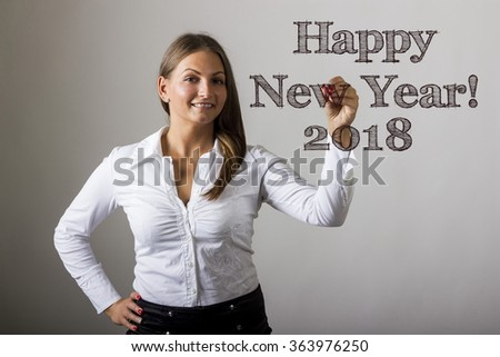 Happy New Year 2018 - Beautiful girl writing on transparent surface - horizontal image