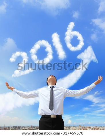 happy new year 2016, Business man hug 2015 (white arrow cloud and blue sky on sunny day) - stock photo