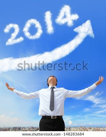 happy new year 2014, Business man hug 2014 (white cloud and blue sky on sunny day) - stock photo