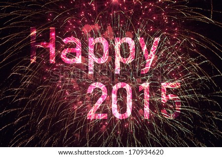 Happy New Year 2015 card showing a delicate burst of fireworks in the night sky with the wording Happy 2015 highlighted - stock photo
