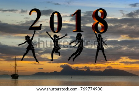 Happy new year card 2018. Silhouette young woman jumping on tropical beach over the sea and 2018 number with sunset background
