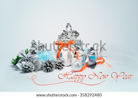 Happy New Year card with colorful blue baubles and acorns - stock photo
