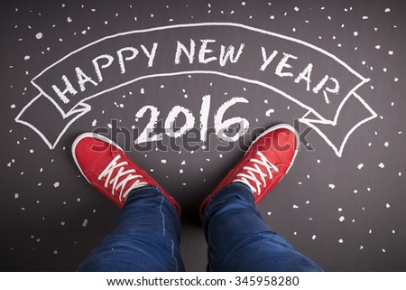 Happy new year composition. Studio shot on wooden background. - stock photo