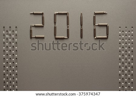 Happy new year 2016 composition with head screwdriver on steel sheet