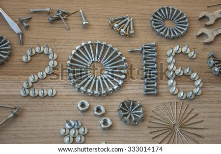 Happy new year 2016 composition with  nails bolts and dowels - stock photo