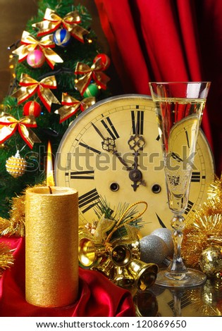 Happy New Year. Composition with old clock, glass of champagne, candle and decorated Christmas tree - stock photo