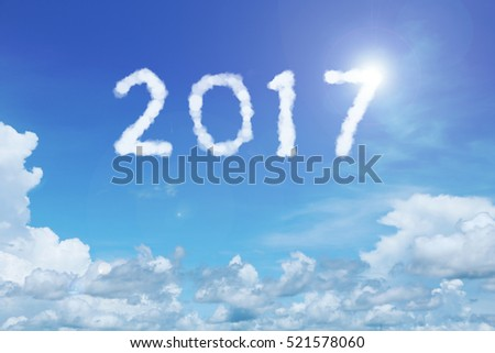 happy new year concept of 2017 clouds on the clear blue sky