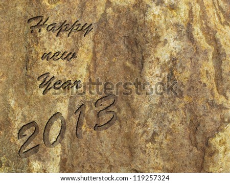 Happy new year 2013 engraved in ancient stone - stock photo