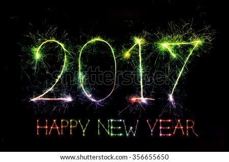 HAPPY NEW YEAR 2017 from colorful sparkle on black background  - stock photo