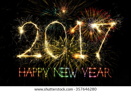 HAPPY NEW YEAR 2017 from colorful sparkle on black background Fireworks light up the sky,New Year celebration fireworks - stock photo