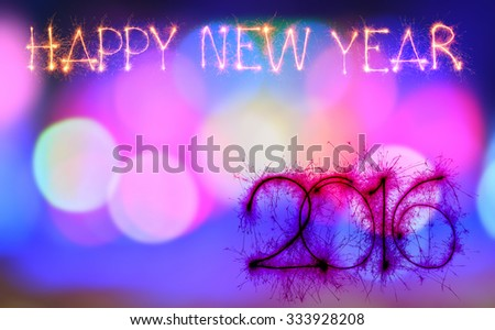 Happy new year 2016 from sparkler on colorful bokeh background - stock photo