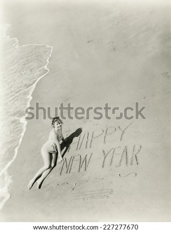 Happy New Year from the beach - stock photo