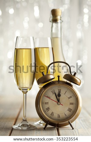 Happy new year - glasses of champagne and alarm clock - stock photo