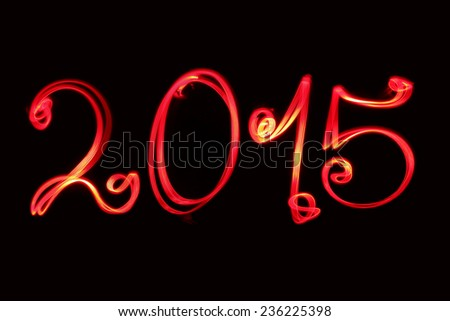Happy new year greeting  2015 - blur photo written by red bike light - stock photo