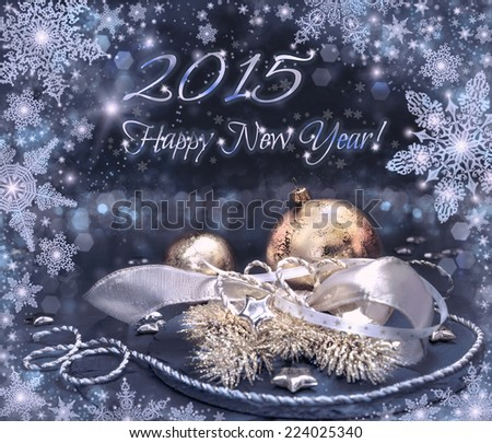 Happy New Year 2015 greeting card in silver, gold and black. Toned, image, shallow DOF, focus on the big ball - stock photo