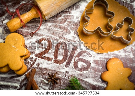 Happy New Year 2016 greeting made of cooking ingredients and utensils for Gingerbread man cookies. Sweet food art, Christmas spirit - stock photo