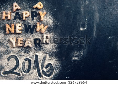 Happy New Year 2016 greeting with cookies letters on dark background with blank space  - stock photo