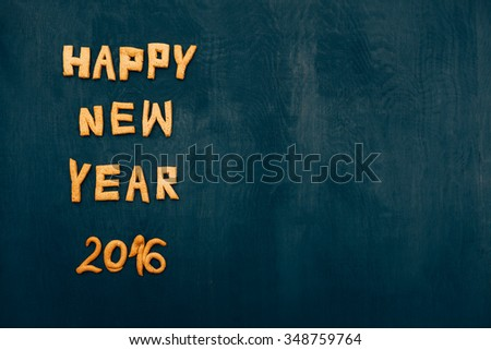 Happy New Year 2016 greeting with Cookies Letters on Dark Background with Copy Space - stock photo