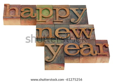 Happy New Year greetings in vintage wooden letterpress printing blocks, isolated on white - stock photo