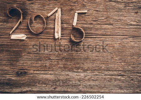 Happy New Year 2015 greetings on vintage wooden background