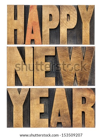 Happy New Year greetings or wishes - isolated text in vintage letterpress wood type blocks
