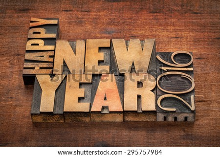 Happy New Year 2016 greetings  - word abstract in vintage letterpress wood type blocks on a grunge wooden background - stock photo