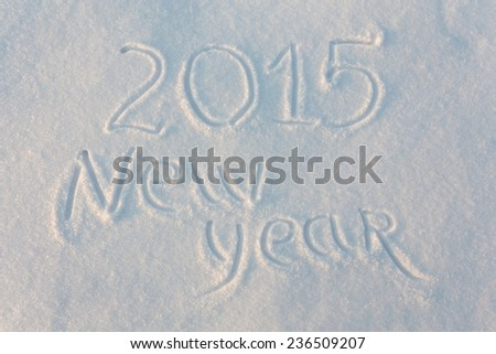 Happy 2015 New Year greetings written on snow