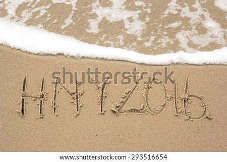 Happy new year 2016 hand written on sand and wave is moving up - stock photo