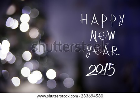 Happy new year 2015 in bokeh and lens flare pattern on christmas tree background - stock photo