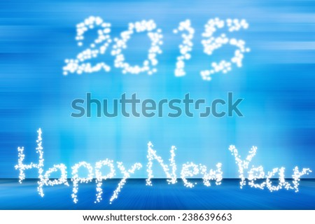 happy new year 2015 in motion and lens flare pattern on summer blue background