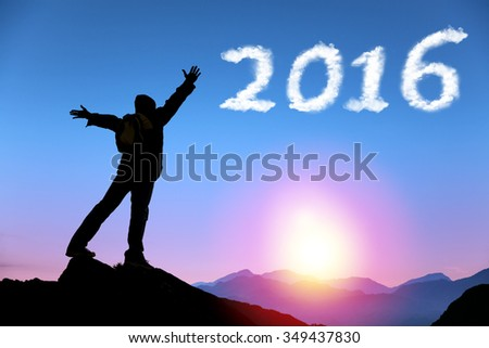 happy new year 2016.man on top of the mountain looking the cloud - stock photo
