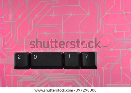 Happy new year 2017 message, keys on the computer background - stock photo