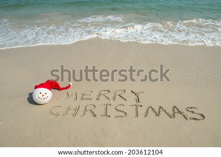 happy new year message on the sand beach - stock photo