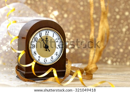 Happy New Year. Old clock on yellow abstract background - stock photo
