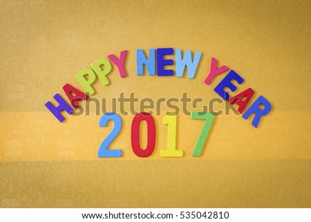 Happy new year 2017 on gold color paper texture background