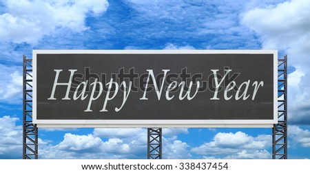 Happy new year on large sign board with blue sky background - stock photo