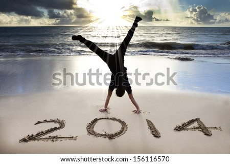 happy new year 2014 on the beach with sunrise - stock photo