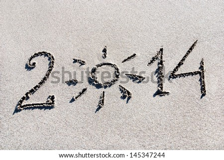 Happy New Year 2014 on the sea beach with the sun