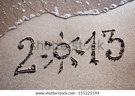 Happy New Year 2013 on the sea beach with the sun rays - stock photo