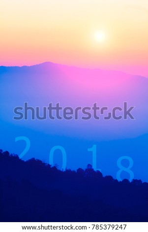 HAPPY NEW YEAR 2018 on top mountains view at sunrise background.