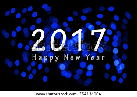 Happy New Year 2017 on unfocused blue light blur bokeh background
