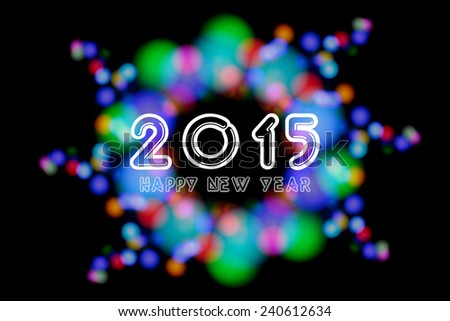 Happy New Year 2015 on unfocused colorful light blur bokeh background - stock photo