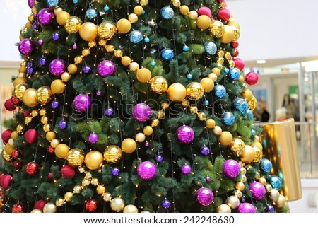 happy new year or merry christmas interior decoration of beautiful christmas tree with color balls and garland - stock photo