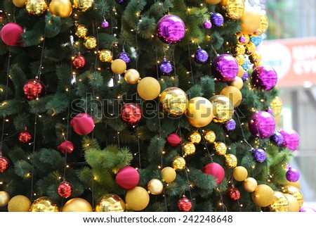 happy new year or merry christmas interior decoration of beautiful christmas tree with color balls and garland