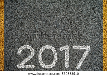 Happy New year 2017 paint on the asphalt road