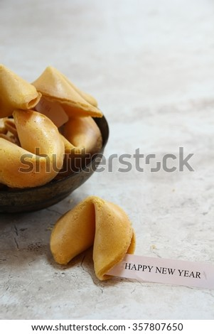 Happy new year quote on Fortune cookie, selective focus - stock photo