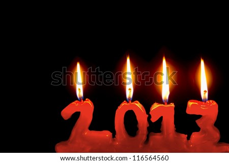 Happy new year 2013, red candles number burning in the dark - stock photo