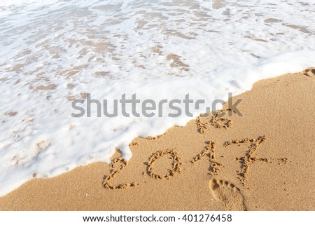 Happy New Year 2017 replace 2016 text on the sea beach - stock photo